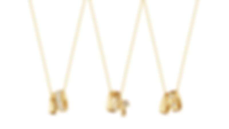 GEORG JENSEN MAGIC系列:18K黃金鑽石鍊墜。
