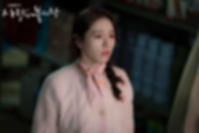 SJYP粉色針織開襟衫。