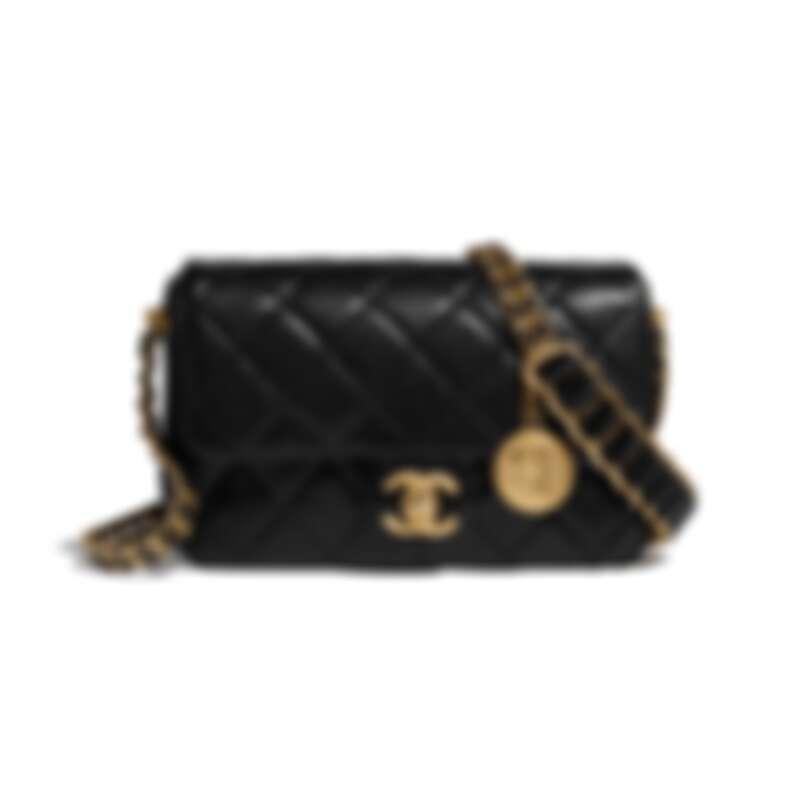黑色皮革飾以金屬徽章雙重皮穿鍊帶肩背包,NT155,900
