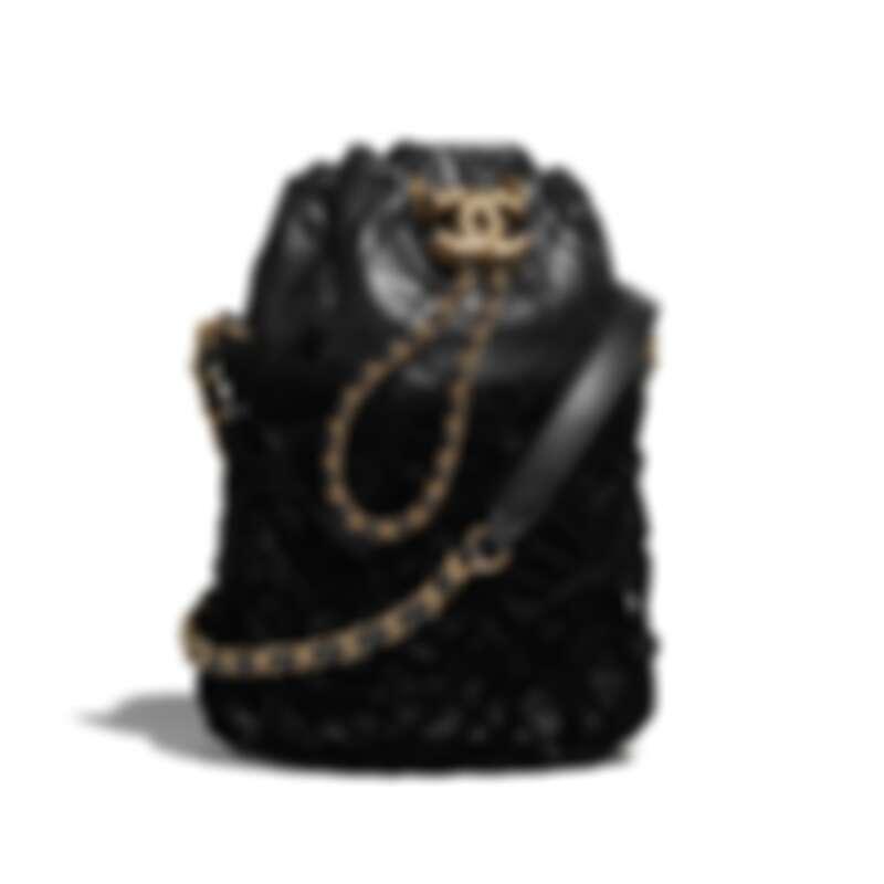 黑色天鵝絨辮飾金屬扣環皮穿鍊束口包,NT177,100